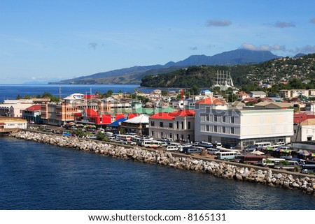 Cruise ship coming into Roseau a caribbean city on the island of Dominica - stock photo