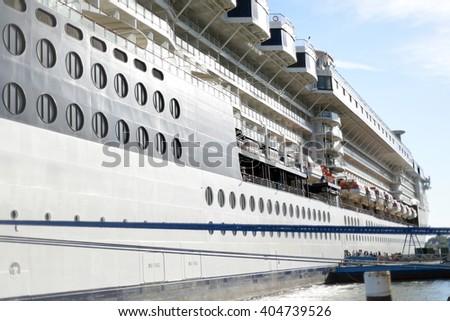 cruise ship docked at cobh in ireland - stock photo