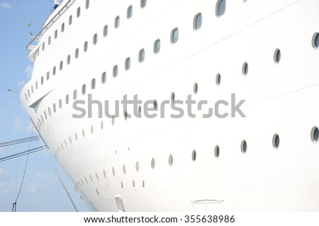 Cruise ship docked at port of call in the caribbean.