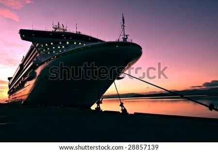 Cruise ship docked in Ushuaia at sunrise - stock photo