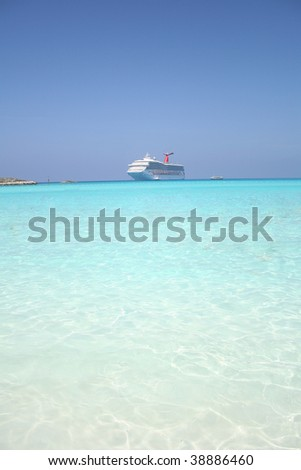 Cruise ship floating in clear water - stock photo