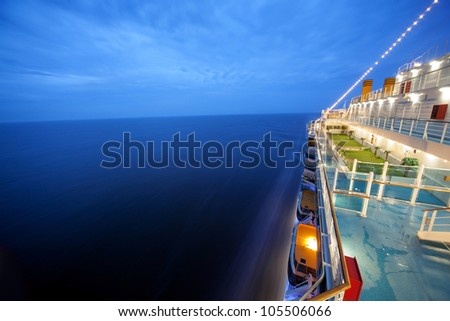 cruise ship floats at night, long exposure - stock photo