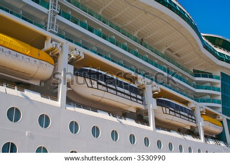Cruise ship hull, balconies & rescue boats.