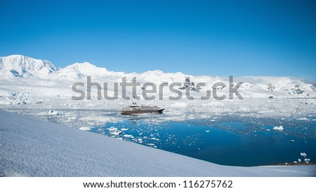 Cruise ship in Antarctica, view from the peak - stock photo