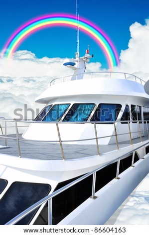 Cruise ship in ocean cloud with rainbow - stock photo