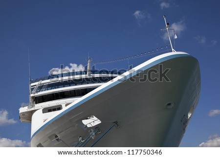 Cruise ship in port against blue sky - stock photo