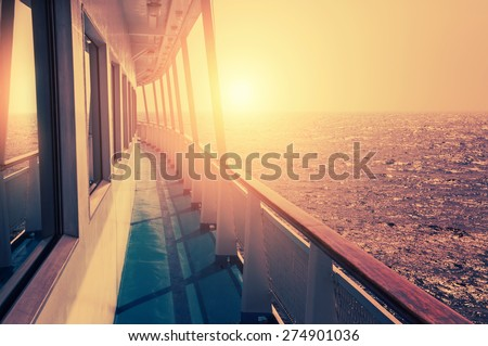 Cruise ship in sea at sunset. Beautiful summer seascape. Creative vintage filter, retro effect  - stock photo