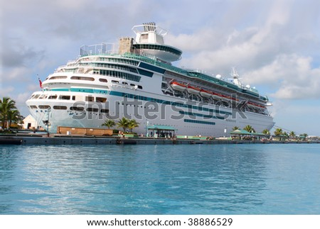 Cruise ship in the clear blue Caribbean ocean docked in the port of Nassau, Bahamas - stock photo