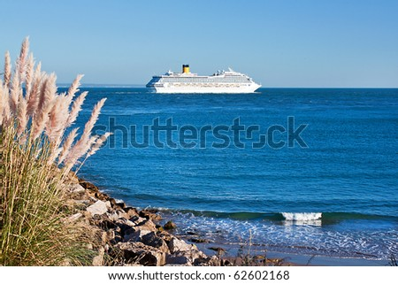 Cruise ship leaving the bar of the river Tagus - stock photo