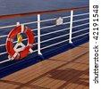 Cruise ship railing and life buoy - stock photo