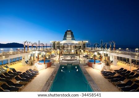 Cruise ship sailing in Alaska at dusk - stock photo