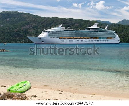 Cruise ship with a kayak in the foreground - stock photo