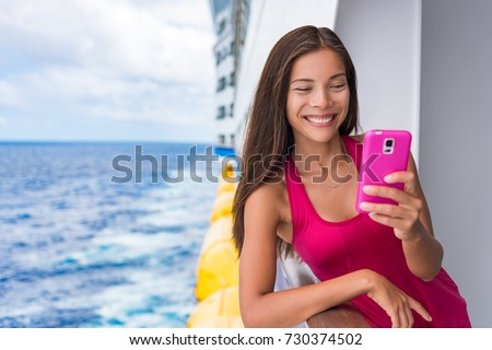 Cruise Ship Woman Using Mobile Phone Stock Photo - Using a cellphone on a cruise ship
