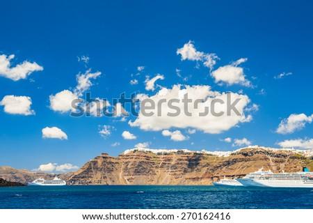 Cruise ships near the Santorini island, Greece. Beautiful landscape with sea view. - stock photo