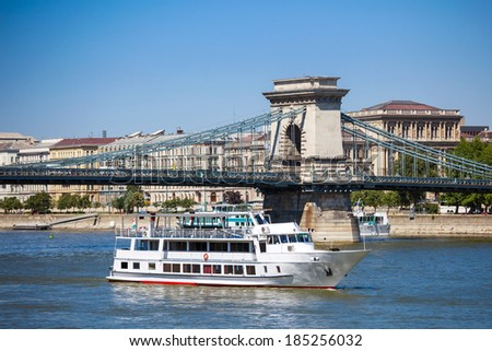 Cruise ships on Danube river with Chain Bridge in front  and Parliament Building in the background, Budapest.