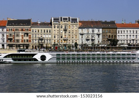 Cruiser with tourists on Danube River in Budapest, Hungary - stock photo