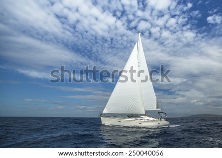 Cruising on a sailing boat. Boat in sailing regatta. Luxury yachts.