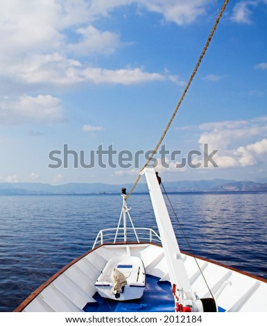 Cruising the blue sea and sky among the Greek islands - stock photo