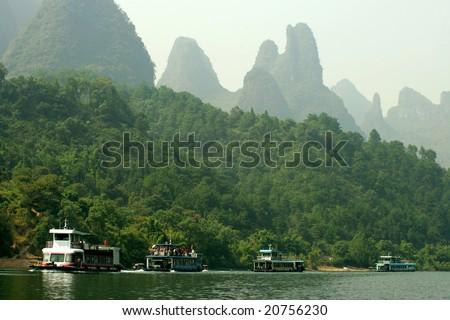 Cruising the Li river near Yangshuo, Guanxi province, China - stock photo