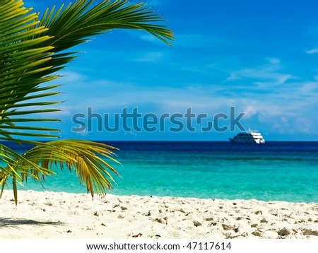 Cruising yacht near the island in the Indian Ocean - stock photo