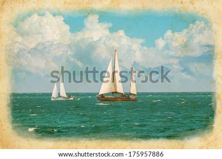 Cruising yachts are racing of regatta sailing. Nautical landscape with two yacht under full sail taking part in regatta race. Maritime romantic trip on the sailing yacht. - stock photo