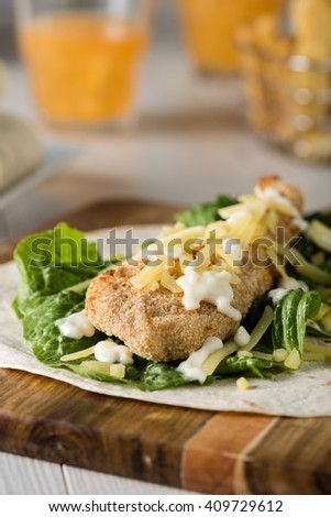 Crumbed Chicken Tortilla Wrap With Fresh Lettuce Cheese