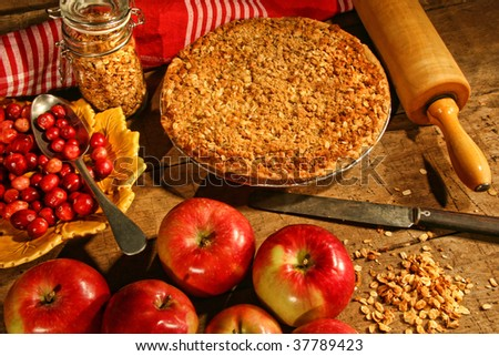 Crumble pie with apples and cranberries for fall baking - stock photo