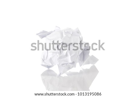 Crumbled paper ball trash close up over white background