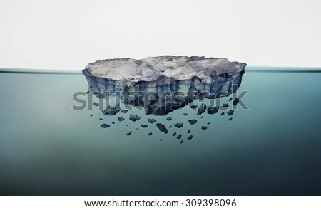 Crumbling rock floating in clar blue water
