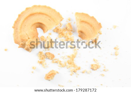 Crumbs of Classic Vanilla Cookies isolated on white background. - stock photo