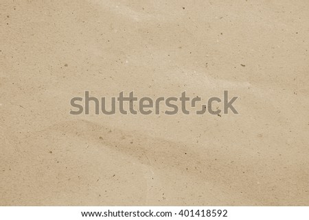 crumpled art plain paper texture for backgrounds in vintage color cream tone style:detail of crease/crinkle of paper texture.art soft brown colored tone wallpaper pattern:rugged carton backdrop - stock photo
