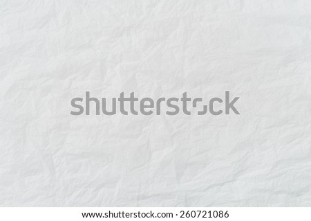 Crumpled background, from a white paper - stock photo