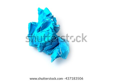 Crumpled blue paper a white background