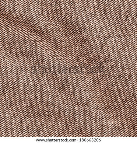 crumpled brown jeans fabric closeup  - stock photo