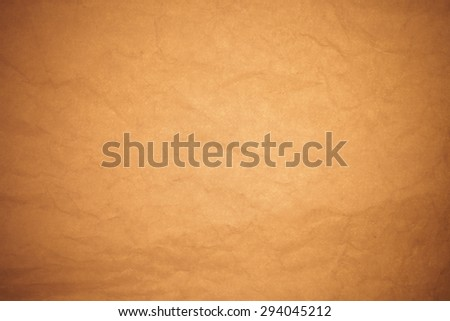 Crumpled brown paper background. - stock photo