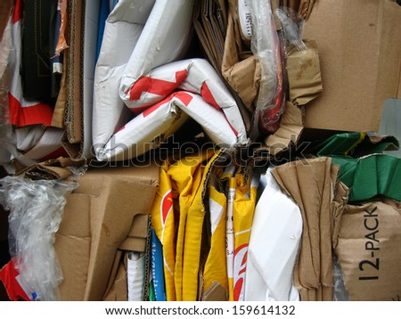Crumpled cardboard and plastic boxes and bags - stock photo