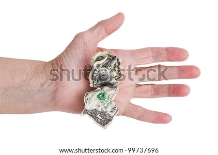 Crumpled dollar in his hand an old man on a white background - stock photo