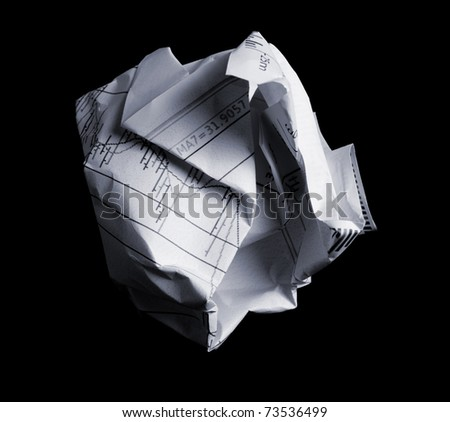 Crumpled financial papers on black background - stock photo