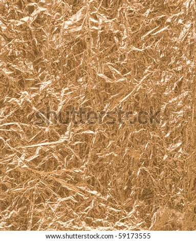Crumpled gold leaf background - stock photo