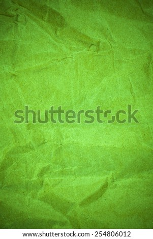 Crumpled green paper texture. - stock photo