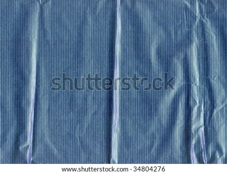 Crumpled, grungy paper background. More of this motif in my port. - stock photo