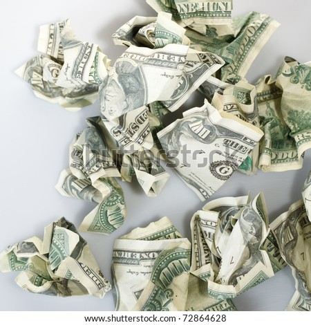 Crumpled money. - stock photo
