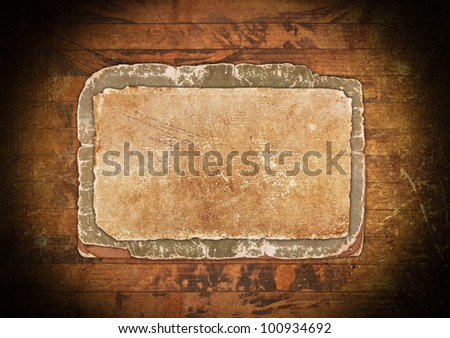 Crumpled old paper on a wooden background