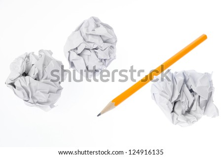 Crumpled paper ball and pencil