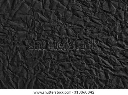 Crumpled paper. Black background - stock photo