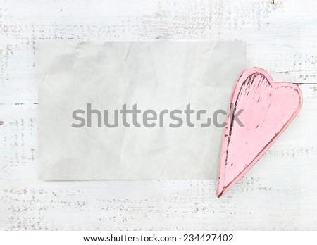 crumpled paper heart on a white background vintage - stock photo