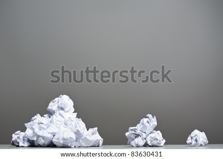 Crumpled paper on a gray background. Closeup.
