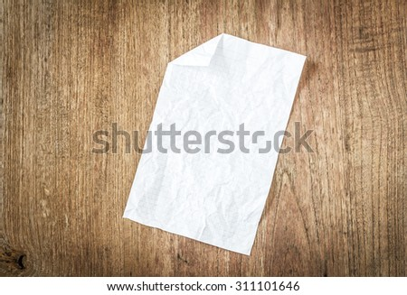 Crumpled paper on old wall - stock photo