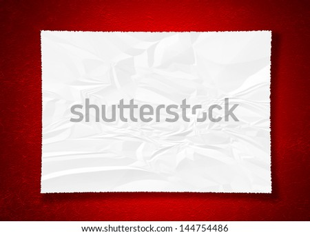 crumpled paper on red