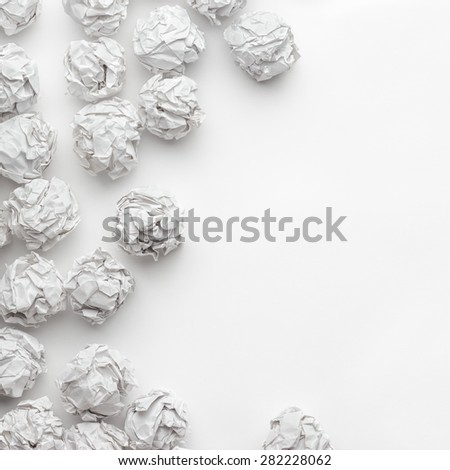 crumpled paper on white table brainstorming in the office - stock photo
